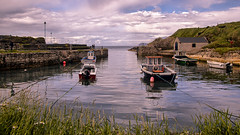 Safe Harbour (TheWildFireOne) Tags: sky water boat blue clouds harbour ocean evening pier riverside quay still waterfront waterway boating jetty motorboat pike lakeside northern ireland ballintoy tourboat 500px