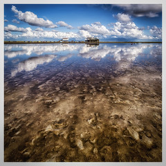 afternoon reflection (juhwie.foto - PROJECT: LEIDENSCHAFT-LICH-T) Tags: spo st peterording nordsee nordseesehnsucht north sea eiderstedt square beach clouds reflection sky pfahlbau pentax pentaxart k1 ricohimaging 1530 landscape landscapephotography seascape
