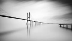 Vasco da Gama opponing pier (frank_w_aus_l) Tags: bridge architecture portugal lisbon lissabon vascodagama fineart nikon d800 sky reflection concrete morning morgenlicht rain