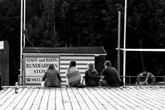 Sitting (Von Noorden) Tags: lübeck street windows black white small strase germany shade schatten shadows dark querstrase hansestadt pflaster copple stone paving copplestone grafiti grafitti art streetart flagstone kopfstein grafitto spray sprayer paint painter gang blockparty block urban cultur kultur gheddo ghetto hood viertel stadtteil stadt city town capital streetphotography streetphoto hamburg noiretblanc einfarbig wand blackandwhite bw sw schwarzweiss topv people teenager teens human humans sitting