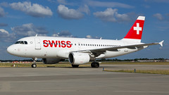 Swiss A319 At Heathrow. (spencer.wilmot) Tags: hbipu a319 swiss lx swr lxswr lhr egll lhregll heathrow london ramp apron airside terminal2 clouds bluesky ops taxiway arrival plane swissinternationalairlines aviation aircraft airplane airliner airport airbus civilaviation commercialaviation passengerjet jet jetliner twin