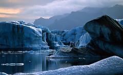 Jokurlsarlon lagoon - Iceland (Frédéric Lefebvre - Landscape photography) Tags: iceberg jokulsarlon islande iceland southerniceland glacier lake water ice marble lagoon mountain blue beautifullight beautifulview beautifulsky landscape paysage cold