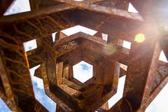 hex ray (primemundo) Tags: rust sky sunrays thingsarelookingup angles hex hexagon lensflare