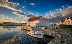 Åkrehamn, Norway (Vest der ute) Tags: xt2 norway rogaland karmøy sky clouds boat houses sea seaside buildings rocks reflections chairs table quay fav25 fav200
