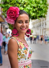 At The Féria Goyesca (WayneToTheMax) Tags: ronda spain feria festival goya goyesca pedro romero bull bullfighter bullfight hemmingway woman lady costume traditional gown celebrate street portrait face pink girl nikon d750