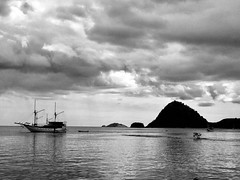 At Anchor (whitehart1882) Tags: relax orient pleasure transport ships seascapes view travel mountains sea indonesia clouds boats ship asia