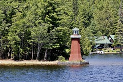 A lighthouse which still works on the Fulton Chain of Lakes above Old Forge NY.      (Explored-Thank you) . (outdoorpict) Tags: blue water lakes fulton chain oldforge adirondacks park northwoods trees lighthouse working sunshine breezy warm secluded