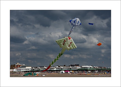 Kites over the pier (prendergasttony) Tags: beach kite flight sea sand lancashire nikon d7200 outdoors colourful fly people england festival st annes ƒ110 mm 1400 iso125 sky clouds red green blue pier elements hobby weather