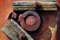 Rusty old farm equipment (holly hop) Tags: mm macro macromonday rust bolt agriculture antique farmmachinery rustyandcrusty wow nuts screws wood abstract red aged abandoned decay oxide oxidation iron corrosion fungus