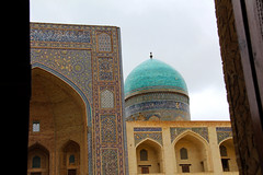 Glimpse of the facade of Mir-i-Arab Madrasa in Bukhara, Uzbekistan from the doorway of Kalyan Mosque