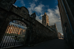 The Quad (Mark Liddell) Tags: standrews fife scotland uk traditional scottish town st salvators quad quadrangle chapel spire tower clock wrought iron gate brick wall stone pavement butts wynd light lamp gutter sunset blue sky clouds andrews 14mm ultra wide angle