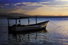 Esperando Zarpe..!! (Nita_Fotos) Tags: boat sun sundown clouds blue orange sea caribbean sol atardecer nubes azul naranja mar caribe sands arena playa lecheria venezuela cielo puesta de espigas viento wind hierba agua paisaje laniñasalvajedelaselva bote