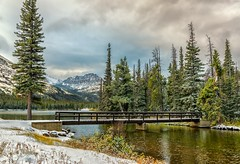 Cool Escape (Philip Kuntz) Tags: storm snow snowfall praylake praylakebridge twomedicine autumn glacier glaciernationalpark montana explore