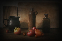 Gustl's Tomatoes (suzanne~) Tags: food vegetable tomato tabletop stilllife indoor jug bottle pitcher lowkey chiaroscuro
