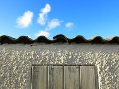 waves under a blue sky (vertblu) Tags: shed roof wall skies blueskies clouds anglesanglesangles wood woodenplanks board boards plaster rendering blue white bluewhite paint oldpaint weatheredpaint vertblu texture textur wavelike wavy inwaves waveshaped roughcast