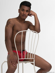 Ashwin (PhotoMechanic.uk) Tags: male man guy dude youth model pose photoshoot studio shirtless topless speedo speedos swimming trunks swimmer swimwear diver red body physique muscle muscular masculine chest nipple sit sitting chair