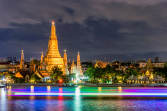 Wat Arun Temple in bangkok thailand at dusk. (MongkolChuewong) Tags: ancient architecture arun asia attraction background bangkok beautiful blue boat buddhism buildings chao chedi city cityscape culture day dusk famous holiday landmark night orange oriental phraya popular religion religious river sky skyline southeast spirituality stupa sunset temple thai thailand tourism tower traditional travel traveler traveller twilight vacations wat water