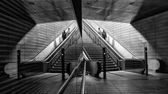 Reflections (laga2001) Tags: street escalator stairs stairway perons peolple black white bw monochrome reflection underground subway city urban architecture leipzig germany pattern structure symmetrical grey couple downstairs