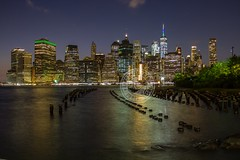 Manhattan Skyline @ Night (Lauren Tucker Photography) Tags: brooklynbridge brooklynbridgepark dumbo landscape nightime view usa us america unitedstates newyorkcity new york nyc ny brooklyn manhattan skyline city bridge hudson river shutterspeed boat iso aperture night rain weather reflection park fence colour color light summer september 2017 cityscape building one world trade centre observatary purple canon 7d marki markii slr camera photography photographer photograph photo image picture copyright allrightsreserved ©laurentuckerphotography
