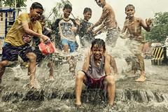 iPhone 7+ in Monsoon Rain (Mio Cade) Tags: monsoon weather rain downpour children boy fun water iphone mobilephone philippines manila tondo play splash flood joy