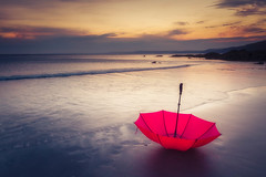 Sunset after the storm (Timothy Gilbert) Tags: panasonic1235mmf28x sunset nikcollection panasonic gx8 umbrella cornwall polhawn whitsandbay red