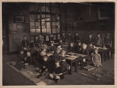 Classroom interior, unknown school (c.1920s) (pellethepoet) Tags: photograph school classroom students children boys girls interior kids pupils schoolchildren groupportrait tables chairs floor games activities learning potplant windows nurseryrhymes