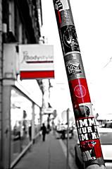 untitled (vienna, austria) (bloodybee) Tags: wien vienna austria europe trip travel street pole sticker sign selectivecolor bw red white highkey flag