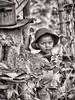 Young boy in Honduras (Pejasar) Tags: treetrunk pot hat home honduras seisdemayo portrait child boy