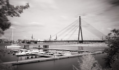 A city on a river (MarxschisM) Tags: riga latvia bw ir long exposure yachts river daugava bridge old town beach