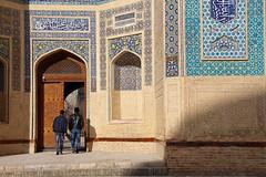 Men heading into Kalyan Mosque in Bukhara, Uzbekistan