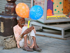 The seller of happiness (Rahul Gaywala) Tags: happy balloon seller sad old man sitting india life irony