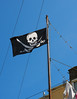 The Jolly Roger flies again (chrisinplymouth) Tags: flag emblem sign jollyroger skull crossbones plymouth devon england uk cw69x plymgrp