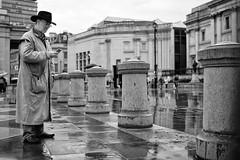 Rain Man (Foto John) Tags: leicam leicam240 leica leicamtyp240 rangefinder summicronm35mmf2asph blackwhite blackandwhite blackandwhitethatsright monochrome streetphotography people man humaninterest rain wet london uk zwartwit
