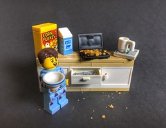 Breakfast time or got up on the wrong side of bed (sponki25) Tags: breakfast time getuponthewrongsideofbed good morning corn flakes milk coffee lego sleeping