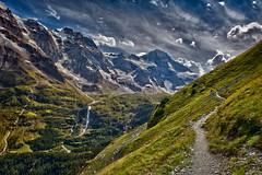 The Breithorn ,   the Schmadribachfall and the high road to Obersteinberg, Canton of Bern . Switzerland No. 7383. (Izakigur) Tags: alps alpes alpen alpi berneroberland bern berne berna ch cantonofbern kantonbern helvetia liberty izakigur flickr feel europe europa dieschweiz lasuisse musictomyeyes nikkor nikon suiza suisse suisia schweiz romandie suizo swiss svizzera سويسرا laventuresuisse lepetitprince myswitzerland landscape switzerland schwyz suïssa d700 nikond700 nikkor2470f28 breithorn road hiking