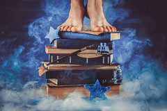 Kid standing on a pile of books in the middle of a cloud of smoke. (Dina Belenko) Tags: ancle art artist author black book cloud collection concept conceptual copywriting cosmos creativity dark desk editing education enchanted fairytale galazy idea learning leg literature magic mystery object paper poet reader religion research science shelf smoke space star stationary stilllife study text wisdom work workplace write writer writing