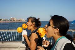 Mangoes (dtanist) Tags: nyc newyork newyorkcity new york city sony a7 konica hexanon 40mm brooklyn coney island boardwalk steeplechase pier labor day mangoes mango eat eating food stick