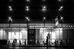 passerby (Iwona Malajka) Tags: city night passerby shops blackandwhite nightshot nightlight urbangeometry citi advert citylight urbanlandscape