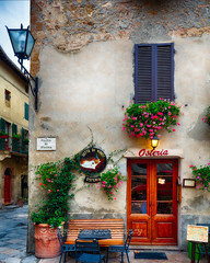 Quaint Restaurant Building in Pienza, Tuscany, Italy (George Oze) Tags: osteria pienza tuscany vald'orcia architecture atmospheric buildingexterior colorful daytime entrancedoor europe fineartphotography foodanddrink fpottedflowers historic historictown inviting italian italy menu nobody oldpatina outdoors quaint relaxing restaurant scenic shutters signs street streetcorner streetlamps streetphotography town traditional travel vertical wine winecountry it
