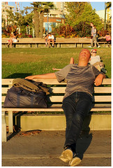 Sunset Nap (HereInVancouver) Tags: candid streetphotography vancouverswestend thingstodobythewater englishbaypark seawall canong3x man outdoors city lifeonaparkbench sunsetlight vancouver bc canada