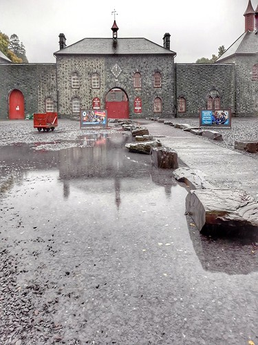 Big puddle reflection of slate museum.