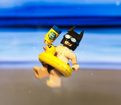 Batman Beach Time (Jezbags) Tags: lego legos toy toys macro macrophotography macrodreams macrolego canon60d canon 60d 100mm closeup upclose batman batmanthemovie dc dclego legodc sun block mask beach sea sand ring summer fun tanning