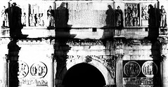 shadows guard the gate (coffee robbie..PROTECTED BY PIXSY) Tags: archofconstantine rome roma roman architecture archeology arch italy italia europe history blackandwhite bw nikond5100 night nikon kitlens manfrotobefree manfrotto triumphalarch shadows light lightroom silverefexpro2