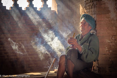 Old man smoking (Khun Hans Outdoor Photography) Tags: myanmar smoking streetphotography street streetphoto eastasia asia backlit backlight availablelight cigars coppercloudsilvernsun asian old man senior lifestyle poor scenic light lightbeams travel