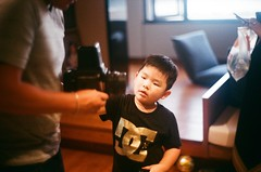 curious about his Grandpa's vintage camera (SiuDull) Tags: leicam4 tee dc curious 福建 福州 fujian fuzhou life kid child memories moment camera vintage fat boy photography indoor light available colour color mount thread screw canon ltm m4 hs1800 noritsu rb67 mamiya candid sooc analog 135 film c200 fujicolor children kids childhood f12 50mm rangefinder leica