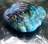 Susi (Laura Blanck Openstudio) Tags: openstudio openstudiobeads huge handmade lampwork glass murano beads bead big hole charm pendant made usa jewelry necklace choker nugget flat wearable whimsical funky odd fine arts art artist artisan abstract asymmetric organic earthy colorful multicolor published winner festival show single focal bold transparent speckles frit shiny spiral swirl blue night navy aqua turquoise periwinkle dark mysterious ocean water beach urchin sterling silver silvered amethyst eggplant plum purple violet green burgundy cobalt lagoon