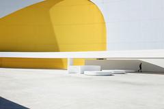 Yellow (*Chris van Dolleweerd*) Tags: minimal yellow person man architecture modern chrisvandolleweerd fujifilm x100s shade sun light urban boy walking