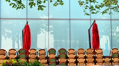 Chairs & Umbrellas, Chicago, Illinois (duaneschermerhorn) Tags: reflection reflective glass windows glassclad mirror distortion umbrella parasol outdoor outdoors chairs empty red redumbrella green brown blue brownchair wicker chicago illinois restaurant