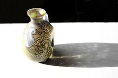014 (antonellomarceddu) Tags: stilllife bottiglia vetro giallo ombra riflesso riflessi