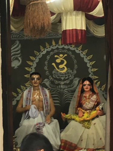 Jagannatha Misra and Saci Devi with baby Nimai at the Yogapith